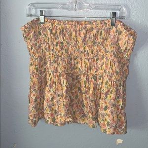 A floral crunched top